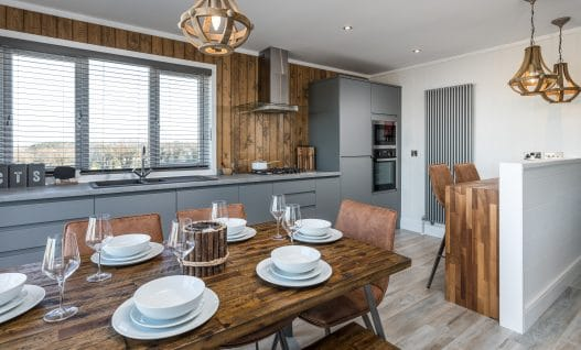 Dining room area in Sennen Luxury Lodge at Trevornick Holiday Park