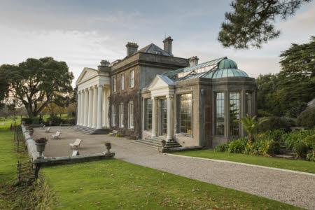 The entrance front and orangery at Trelissick, Cornwall